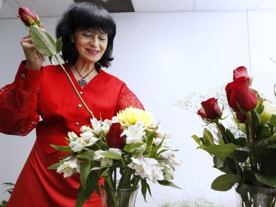 Margareta Fratila prepares Valentine's Day bouquets in 2012 at her floral shop, Margaret's Greenhouse & European Floral Designs.