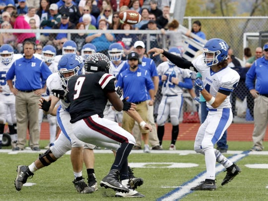 Horseheads quarterback Jack Chalk throws the ball over