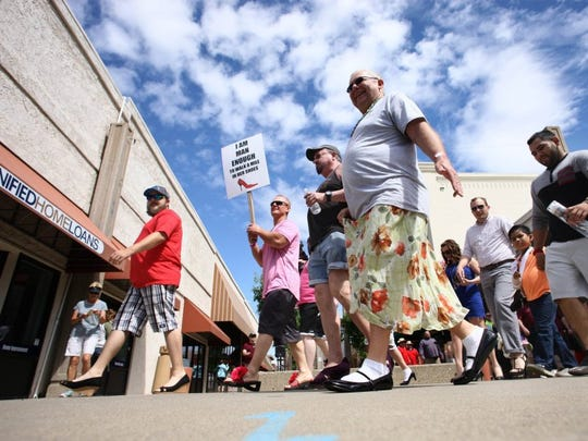 Hung Vu/Special to the Record SearchlightMen march down Placer Street in women's shoes Saturday during the Walk a Mile in Her Shoes event in downtown Redding. The annual event raised money for One SAFE Place.