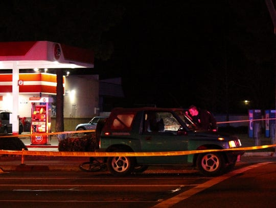 Redding police investigate at the scene of a fatal