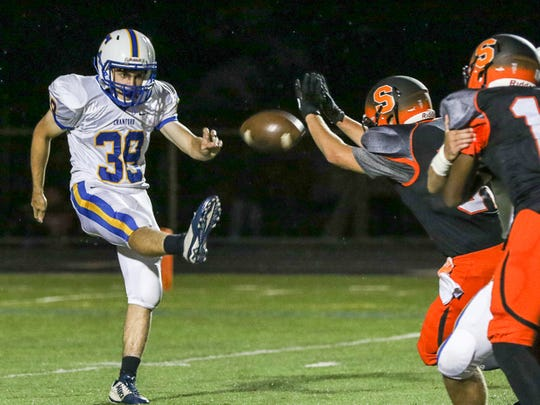 Somerville's Sean Aira-Speiss, right, blocks a punt by Cranford's Jake McAleavey (39) at Somerville on September 8, 2017. (Photo by Keith Muccilli, Correspondent)