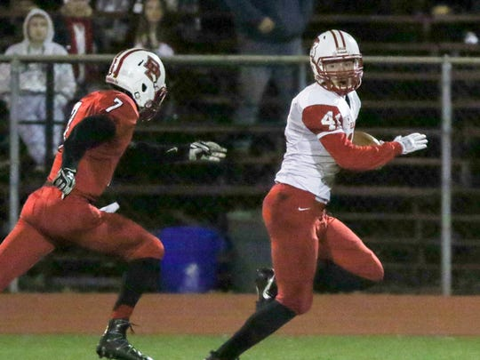 Point Beach's Jean Verrier (right) outruns Bound Brook's final defender David LePoidevin III to score a touchdown in the Central Group I semifinals on Friday, Nov. 17, 2017.