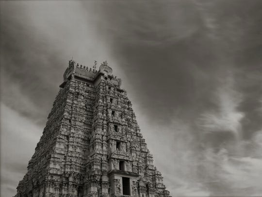 A carved stone temple in Trichi, India, is featured in this photograph by Kenro Izu.
