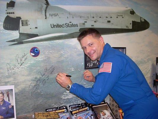 Astronaut Wheelock signing Kopernik Observatory's Wall of Fame.JPG