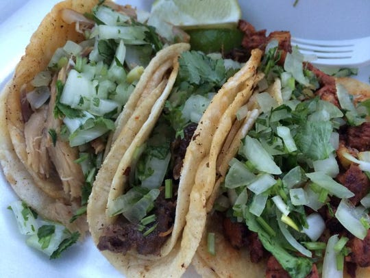 Tacos filled with carnitas, barbacoa and al pastor