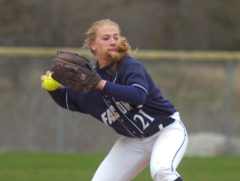 Infielder Claire Knie hurries to get the ball to the first baseman.