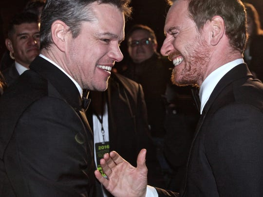 Actors Matt Damon (left) and Michael Fassbender (right) ran into each other while signing autographs to fans during this year's edition of the Palm Springs International Film Festival gala on Saturday.