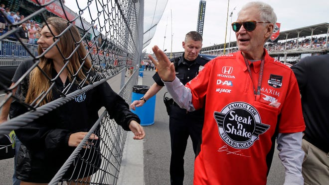 David Letterman, who ended his 33-year career as a late-night television host Wednesday, waves to fans as he walks through the pit area before the 99th running of the Indianapolis 500 auto race at Indianapolis Motor Speedway in Indianapolis, Sunday, May 24, 2015.
