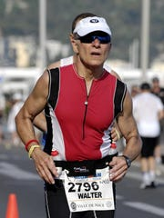 Walt Pheney of Farmington Hills does the running portion of an Ironman in Nice, France.