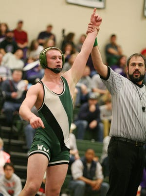 Zac Denton of Wilson Memorial has his arm raised after defeating Christian Munoz of East Rockingham in the 170-pound final at the Region 2A East Tournament on Saturday, Feb. 13, 2016 at Wilson Memorial High School in Fishersville.