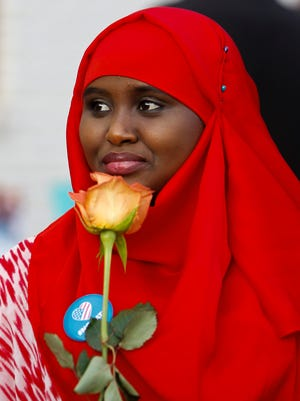 Several hundred people of multiple faiths, including Ibin Hassan, a refugee from Somalia, gathered Monday, Feb. 20, 2017, at the Islamic Center of East Lansing for a prayer vigil.  Prayers and blessings were said in multiple languages by leaders of about a dozen different local area churches and organizations.