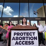 Samantha Romero talks about her abortion and the Supreme Court's decision to strike down Texas' restrictive abortion law Monday outside the El Paso County Courthouse.