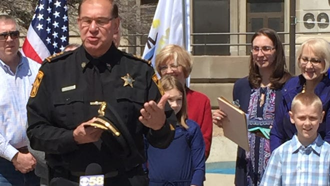 Acting Milwaukee County Sheriff Richard Schmidt stood with family and friends at the Courthouse Tuesday in announcing he will run as a Democrat in seeking a full four-term to the office in the fall election.