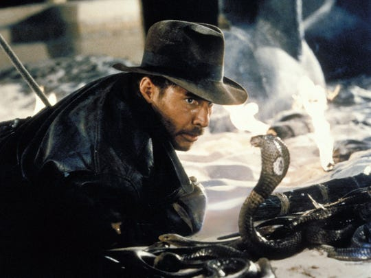 """Harrison Ford comes face-to-face with a cobra in a scene from the Indiana Jones adventure """"Raiders of the Lost Ark"""" in this undated promotional photo."""