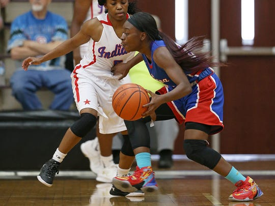 From left, senior Lauren Dickerson (5), of Lawrence North, guards junior Dana Evans (21), of Gary West, during the Indiana girls junior All-Stars versus senior All-Stars, at Bloomington South High School, Bloomington, Ind., Tuesday, June 7, 2016. The senior All-Stars won, 111-79.