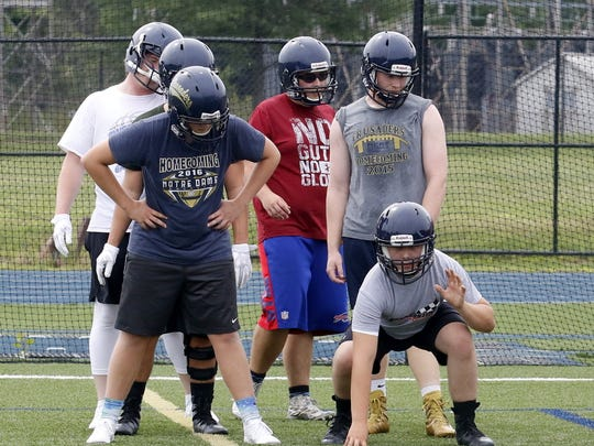 Elmira Notre Dame football players run through a drill Aug. 14 at Brewer Memorial Stadium.