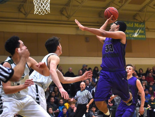 Spanish Springs' Marcus Loadholt (33) drives to the