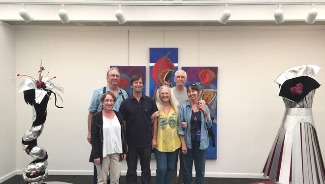 The exhibit's installation crew and the artwork.   Left to right:  Chuck Corbett, Jaye Houle,  Mark Fletcher,  Terrie Corbett,  Kent Griffin,  Mariann Kearsley.
