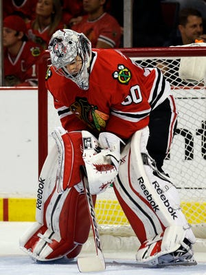 Blackhawks goalie Corey Crawford looks down after allowing a goal during Game 2. Crawford allowed five goals in the game.