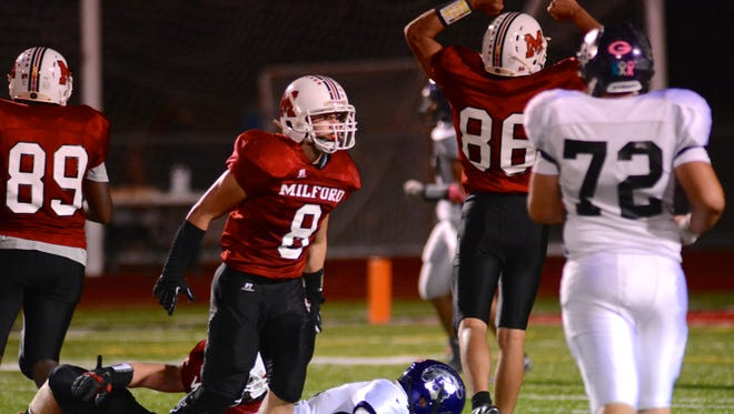 Alex Young, No. 8, has been a vital part of the Milford High School football team in 2014.