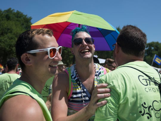 L. Owen Taggart of Washington, center, with the Washington Gay Men's Chorus, celebrates after singing on the National Mall during the Equality March for Unity and Pride in Washington, Sunday, June 11, 2017.