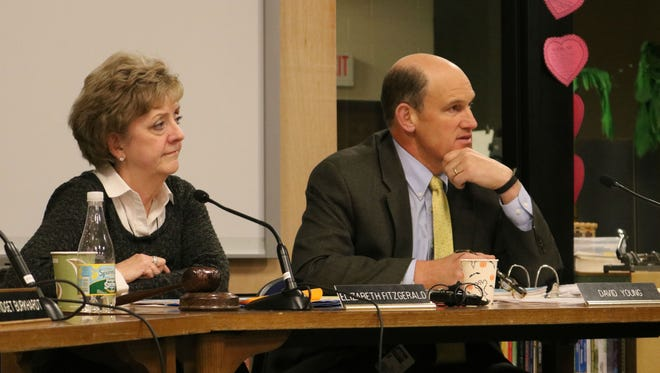 Chairwomen Elizabeth Fitzgerald and Superintendent David Young listen to comments at a school board meeting on March 15, 2017.