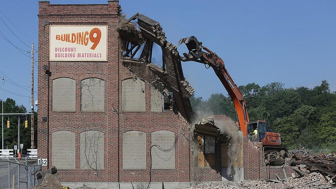 The historic industrial building at 132 Walnut Road SW in Massillon was torn down on Thursday. The former tenant, Building 9, left the facility in November 2019.