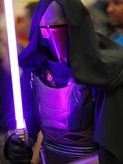 Ryan Miller in a Darth Revan costume that he purchased for 1500 dollars, during Gen Con at the Indiana Convention Center, Indianapolis, Saturday, August 6, 2016.