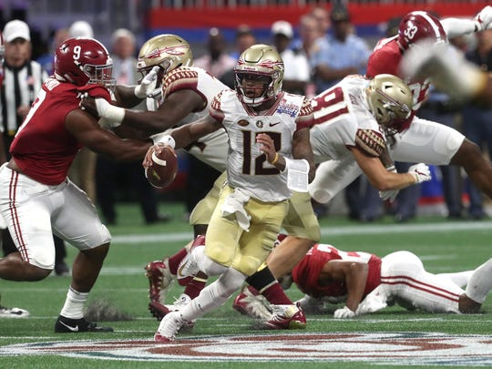 FSU's Deondre Francois scrambles out of the pocket against Alabama during their game at the Mercedes-Benz Stadium in Atlanta on Saturday, Sept. 2, 2017.