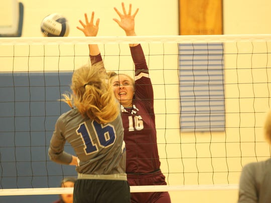 Bronte High School's Kristen Stilley tries to block a shot by Midland Christian's Shayla Ellison in the Gold Division of the Nita Vannoy Memorial Volleyball Tournament at Lake View's Ben Norton Gym on Saturday, Aug. 18, 2018.