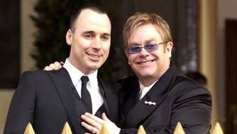 Elton John (R) and David Furnish after their civil partnership ceremony, in Windsor, on Dec. 21, 2005. Now the couple are legally married.