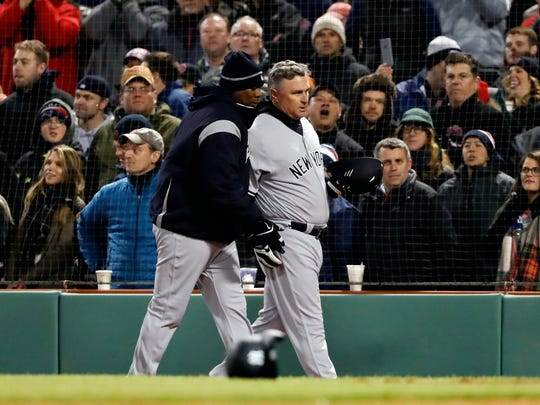 Apr 11, 2018; Boston, MA, USA; New York Yankees third base coach Phil Nevin (53) is escorted off of the field after a scrum during the seventh inning against the Boston Red Sox at Fenway Park.