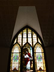 A crew from Bovard Studio, Inc. recently made repairs to this large stained glass window at Drummondtown United Methodist Church in Accomac, Va. on Friday, Aug. 26, 2016. A crew from the studio is fixing the church's stained glass windows and putting new glass covers on them.