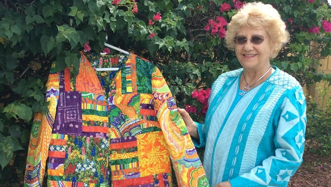 Nancy Lee shows off one of her custom quilted jackets at her favorite part of town, Buena Vida Estates.