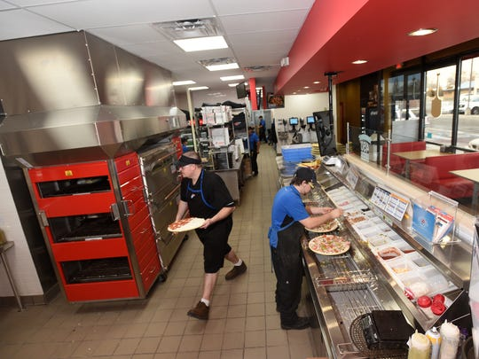 Manager John Miller, left, and Zach Tarver work at the new Domino's location on Wednesday in Bloomfield.