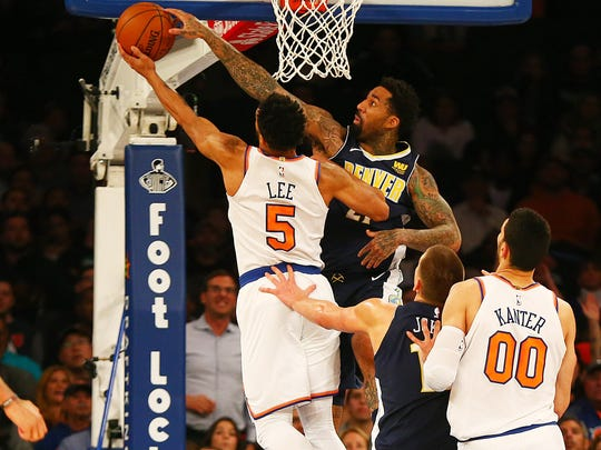 Courtney Lee goes up for a shot while being defended by Denver Nuggets forward Wilson Chandler during the first half at Madison Square Garden.