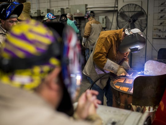 Shane Theall, an agriculture and welding teacher at Abbeville High School, works during a Jump Start program at South Louisiana Community College in July 2015. The district wants to increase its career diplomas and workforce preparation.
