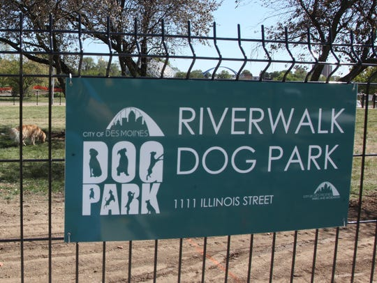 A couple enjoys a walk around the Riverwalk Dog Park