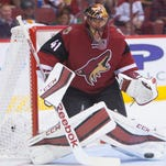 Coyotes goalie Mike Smith makes a save on a shot from the Wild's Jason Zucker (16) at Gila River Arena in Glendale on October 15, 2015.
