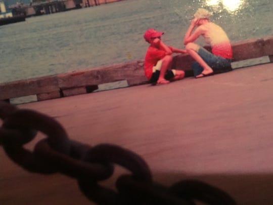Lori Iverson talks to her son Hayden on a pier in Houston while receiving chemotherapy for cancer in 2009. This was one of the last photos taken of Lori before she died at age 27.