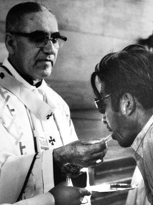 Archbishop Oscar Arnulfo-Romero offers the host wafer during the communion rite to a member of the congregation during a church mass in San Salvador, El Salvador on Jan. 13, 1980. Pope Francis has cleared the way for slain Salvadoran Archbishop Oscar Romero to be made a saint, declaring that a churchman who stood up for the poorest of the poor in the face of right-wing oppression should be a model for Catholics today.