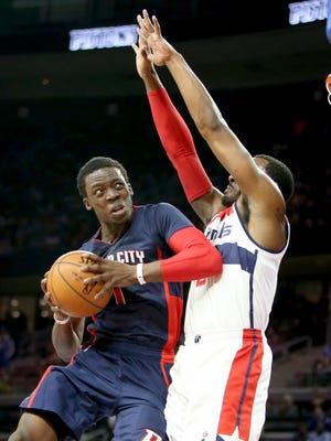 Detroit Pistons guard Reggie Jackson drives against the Washington Wizards' John Wall during the second period on Sunday, February 22, 2015 at The Palace of Auburn Hills.