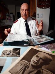 World War II veteran Donald Tolhurst looks through photo albums at his Asbury Park home.