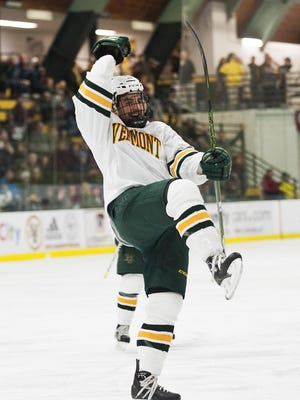 Vermont's Brady Shaw (22) celebrates scoring a goal during the men's hockey game between the Bentley Falcons and the Vermont Catamounts at Gutterson Fieldhouse on Saturday.