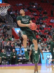 Miles Bridges dunks in a practice in preparation for the NCAA tournament Thursday, March 15, 2018 at Little Caesars Arena.