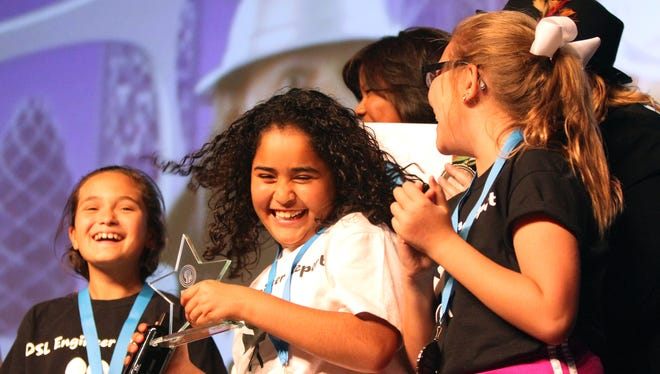 Della S. Lindley Elementary fifth-grader Azlynn Lara smiles after receiving an award during the 2016 DIGICOM Film Festival held at the Palm Springs Convention Center in Palm Springs.
