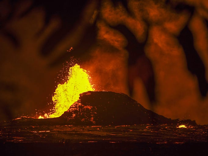 Lava from the Kilauea Volcano pours out of fissures