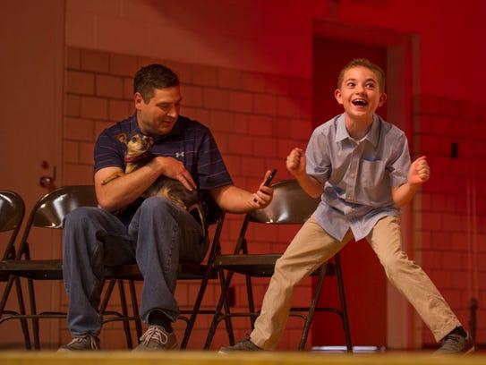 Ethan Eichelholz, 9, celebrates as his mom, Kristina