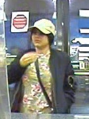 Surveillance of woman who placed ATM scamming device in ATM, police said.