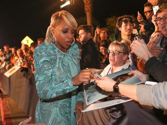 Mary J. Blige signs for fans at the Palm Springs International Film Festival Awards Gala in Palm Springs, January 2, 2018.